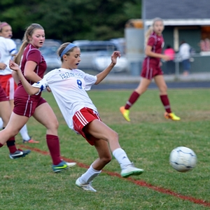 Christine Levesque moves the ball upfield